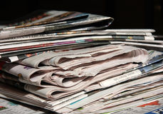 Newspapers. A stack of newspaper on the table Stock Photo