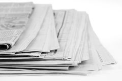 Newspapers. Closeup of stack of newspapers Stock Photos