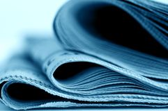Newspapers. Close up of rolled newspapers stock photography