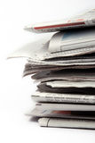 Newspapers. Stack of newspapers on white isolated background Royalty Free Stock Photography