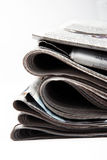 Newspapers. Stack of newspapers on white isolated background Stock Image