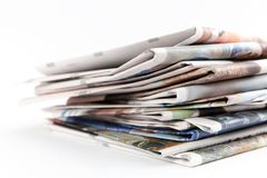 Newspapers. Stack of newspapers on white background Royalty Free Stock Photos