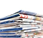 Newspapers. Stack of newspapers on white background Stock Image