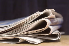 Newspapers. Newspaper on dark blue background Stock Photos