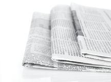 Newspapers. Stack of newspapers isolated on white Royalty Free Stock Photos