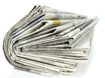 Newspapers. Stack of newspapers isolated on white Stock Image