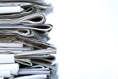 Newspapers. Stack of newspapers on white background Royalty Free Stock Photo