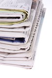 Newspapers. Pile of newspapers isolated on white background Stock Photos