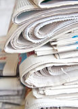 Newspapers. Large number of newspapers, folded in a stack Royalty Free Stock Photos