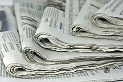 Newspapers. Against plain background shot with very shallow depth of field Stock Image