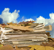 Newspapers and autumn leaves against the sky Stock Photography