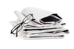 Newspapers and black glasses Stock Image