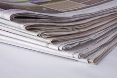 Newspapers - bottom corner stack stock photography