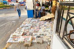 Newspapers and bread in the street. Royalty Free Stock Image