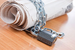 Newspapers with chains On a wooden table Royalty Free Stock Image