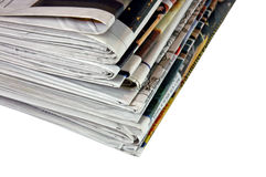 Newspapers  (with clipping path). A stack of newspapers waiting to be read Stock Photography