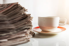 Newspapers and Coffee Stock Photos