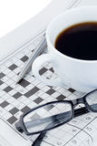 Newspapers and crossword puzzle. On a white background Stock Image