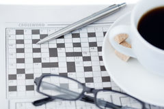 Newspapers and crossword puzzle Stock Photos