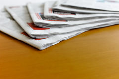 Newspapers on the desk Stock Photos