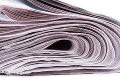 Newspapers Detail. Detail of stacked newspapers on white background Stock Images