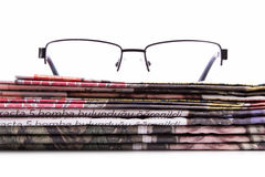 Newspapers and Eye Glasses Royalty Free Stock Photography