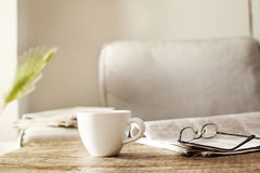 Newspapers with eyeglasses and coffee Stock Images