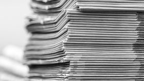 Newspapers folded and stacked BW Royalty Free Stock Images