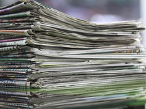 Newspapers folded and stacked concept for global communications Stock Photos