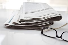 Newspapers folded and stacked concept for global communications. stock photography