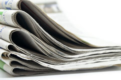 Newspapers folded and stacked Royalty Free Stock Image