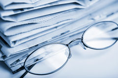 Newspapers and glasses Royalty Free Stock Image