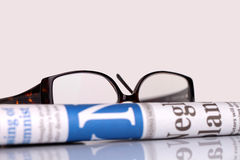 Newspapers and glasses Stock Photo