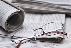 Newspapers and glasses Royalty Free Stock Photos