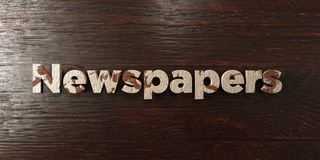 Newspapers - grungy wooden headline on Maple  - 3D rendered royalty free stock image Stock Images