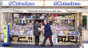 Newspapers in Italy. Newspaper stand in Monza, Italy. Outside a newspaper and magazines kiosk with international and national press Royalty Free Stock Images