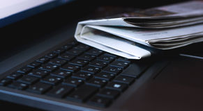 Newspapers on the laptop. Online news. Stock Images
