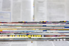 Newspapers and magazines background concept. Newspapers and magazines blurred background concept Stock Image