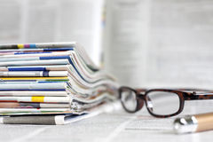 Newspapers and magazines background concept. Newspapers and magazines blurred background concept Stock Images