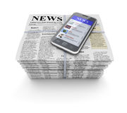 Newspapers and mobile Stock Photography