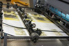 Newspapers at offset printed machine Royalty Free Stock Image