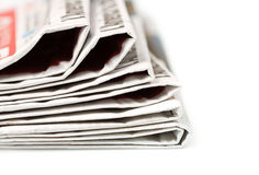 Newspapers over white background Stock Images