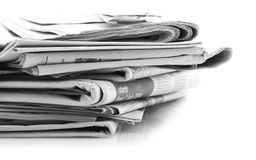 Newspapers over white background Royalty Free Stock Images