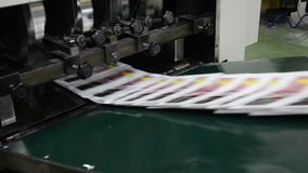 Newspapers on packing line stock footage