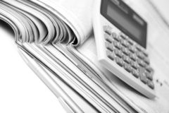 Newspapers, pen and calculator Stock Photography