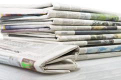Newspapers. Pile of Various newspapers over white background Stock Images