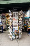 Newspapers for sale at French kiosk on a Paris street. PARIS, FRANCE - MAR 15, 2018: Vertical photo International newspapes stack with portrait of Stephen Stock Photos