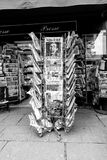 Newspapers for sale at French kiosk on a Paris street. PARIS, FRANCE - MAR 15, 2018: Vertical photo International newspapes stack with portrait of Stephen Royalty Free Stock Photos