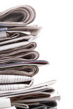 Newspapers, side view Stock Photos