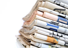 Daily Newspapers. Stack of international newspapers on white background Royalty Free Stock Photos